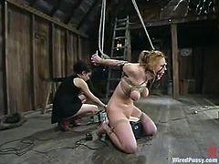 Darling gets bound by insatiable dominatrix Princess Donna Dolore. Donna decorates Darling's tits with wires and then fucks the bitch's snatch with a toy.