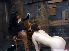 Amazing Black mistress spanks Lilly's ass and ties her up. After that they toy each others asses and pussies with dildos and a strap-on.