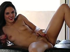 Young dark haired slutty Logan Drae with natural boobies and hot slim body in red shoes only teases with tight ass and touches hairy twat in arousing solo session.
