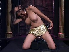 Captivating Asian chick Mika Tan dances seductively and strokes her awesome body. Then she licks a dildo attached to a fucking machine and takes it in her sweet pussy afterwards.