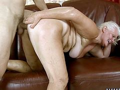 Horny stud treats time worn blonde mommy Jdu with his massive cock. Phat MILF gets her loose hairy cunt fucked doggystyle.