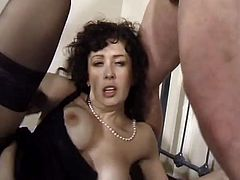 This mature woman loves sex very much, especially with younger men. This time she fucks two guys. She sucks their dicks and gets fucked in her ass and hairy pussy.