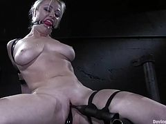 Blonde girl gets tied up and toyed deep in her vagina. After that she also gets her nipples tortured with different devices.