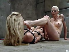 Amazing blonde girl lies on the floor being tied up. Then Ashley licks Lorelei's pussy and toes. After that Ashley also gets her pussy toyed with an electro dildo.
