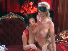 Blonde girl in red lingerie licks feet and gets clothespinned