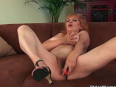 Gunda is a busty grandmother who didn't lose her sexual appetite. She has fun by herself and her hairy pussy with the help of a red vibrator that satisfies her cunt.