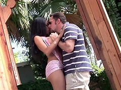 Long-haired brunette Havana Ginger is getting naughty with some dude in the garden. They fondle each other passionately and then fuck in the reverse cowgirl and other positions.