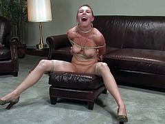 Brown-haired milf Sasha Lexing strips in the living room and lets some man bind her. Then the dude slams Sasha's coochie with a toy and makes her cum soon.