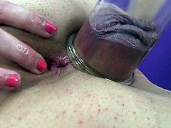Staggering beauty amazes by posing while gently masturbating her pink vag