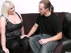 Sindy is a heavy category lady that enjoys having fun with men. This guy is happy to please her so he begins to play with her huge boobs and suck her nipples. All that turned her on so she goes down and dirty for his penis. The chubby blonde takes out his dick and sucks it lustfully!
