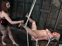 Adorable Lorelei Lee gets tied up and gagged by Claire Adams. Lorelei gets her tits licked and pussy lips clothespinned. Later on she also gets whipped and toyed rough.