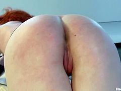 Justine Joli is the redhead chick getting spanked and fingered in a torture lesbian femdom action video by Bobbi Starr.
