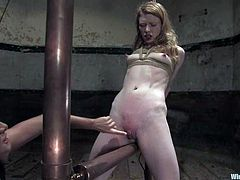 Madison Young and Sandra Romain are getting naughty in a basement. Sandra binds Madison, decorates her ass with electric wires and then fucks her juicy snatch with a strapon.