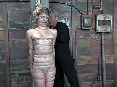 Slim blonde Tawni Ryden is finally getting her punishment. She gets bound by some dude in a basement and moans in pleasure while the guy drills her vag with a dildo.