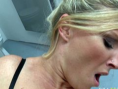 Luscious blonde hoe with big boobs is jumping intensively on top of hard shaft. She then gets banged brutally doggy style.
