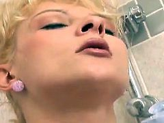 Fat blonde chick with huge boobs takes a shower. She fondles ad shows her wet pussy in close-up scenes. Then she gives passionate blowjob to Black dude.