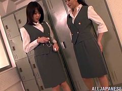 Sexy Japanese chicks in stewardess uniform have lesbian fun in the locker room. These hotties lift skirt up and play with their hot pussies.