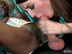 Ebony slut and brunette hoochie serve one well-endowed guy at the highest level. Ebony chick rides cock reverse and white one sucks it greedily.