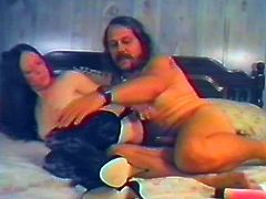 Get a load of this vintage video where this horny mature brunette masturbates with a dildos and her own fingers before sucking and riding this guy's hard cock.