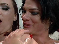 Things got hot and heavy in the sauna for mom Berlin and shemale Gina. They've decided to take a shower together when the sexy redhead mom found out what a hard dick our shemale has. She bent over and got fucked from behind before kneeling like a whore to swallow cock and offer one hell of a titjob.