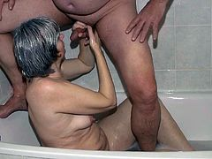 This insatiable granny knows how to make bath time fun for everyone. She masturbates in front of her lover. Then she pleases him with a blowjob.