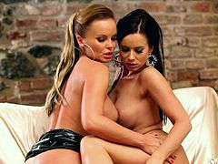 Silvia Saint and Cindy Dollar pose for the camera in high heels and latex dresses. Then these beauties lick each others shaved pussies with pleasure.