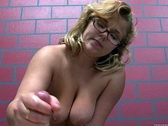 Kinky minded blondie in black lacy panties sits on her knees topless and greedily blows her partner's cock biting it from time to time.