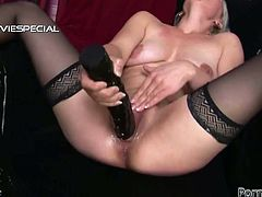Lewd blonde hoe with saggy natural tits is wearing black nylon stockings. She sits with her legs wide open in front of the camera. She fingers her pussy passionately. Later on she slides fat dildo into her pussy hole moving the toy in and out intensively. Julianna moans wild.