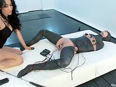 Miss Love gives her obedient sex slave, Wenona, some special attention. Wenona is tied up and blindfolded. She has electrodes on her tits and thighs. Love likes her that way and begins to play with her body, taking her time all the way. She socks the slut and then stays with her pussy on her face.