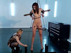 Stunning brunette girl with slim body gets tied up by blonde Aiden Starr. After that she gets stimulated by electricity.