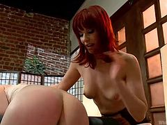 Hot blonde Ella is being dominated and ass slapped by Maitress Madeline. The redhead gives that sexy ass one hell of a spanking and then, lays her on her back, to play with those big boobs. Yeah, she loves to grab them hard and to induce Ella a lot of pain.