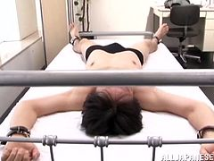 There is a sexy dress underneath her uniform and she ties up her patient and starts treating him like a dog! All she needs is a straight up cock!
