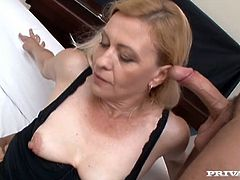 Skilled milf tries to satisfy two raunchy dudes. One pokes her face and another one penetrates her juicy pussy in cowgirl style position.