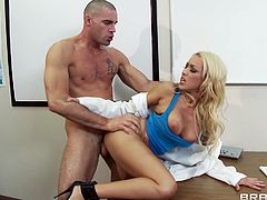 Sexy blonde porn actress bends over the copy machine getting nailed hard doggy style. She then gets down on her knees sucking solid pecker.