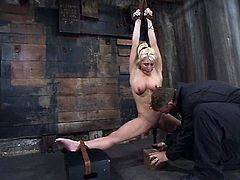 This smoking hot babe is so flexible and her master loves it. He spreads he legs damn wide, having hanged her up her hands on the ceiling.