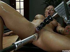 Sweet blonde Holly Heart is getting naughty in a study. She sits down on a desk and gets her snatch drilled remarcably well by a fucking machine.