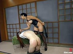 Charlie Hustle is having BDSM fun with Asian dominatrix Mika Tan. Mika binds Charlie and beats him with a stick and then drills his ass deep and hard with her toys.