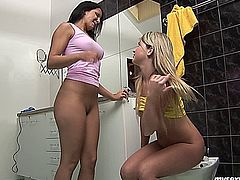 Splendid teen lesbian babes Lisa and Sandra licking and fingering their petite twats on the bathroom floor