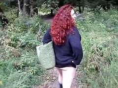 Curly redhead chick with juicy boobs and butt gives a blowjob in a forest. Then she lies down on the ground and gets fucked hard in POV scenes. She also gets her mouth filled with cum.