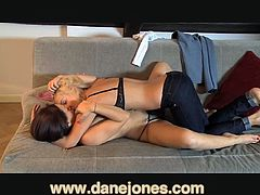 A captivating blonde and a sizzling brunette are having fun indoors. They make out passionately and then drive each other crazy with cunnilingus.