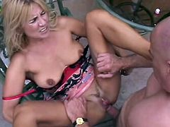Sexy blonde mom Treasure is playing dirty games with some bald stud in the yard. The man favours the hottie with cunnilingus and then they have anal sex in missionary position.