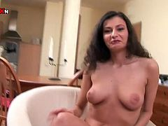Luscious brunette girl with natural tits is sitting naked in front of camera. She is incredibly seductive and hot woman. Luisa slides four fingers in her slick pussy hole.