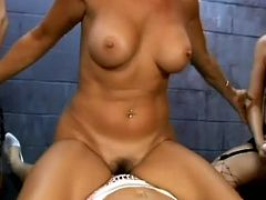Check out this crazy lesbian orgy going on inside a prison with strapon action and more. It's like a gangbang with cops and inmates alongside.