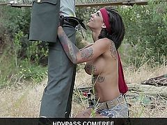 After being captured, busty tattooed vixen Bonnie Rotten strips for the general, revealing her huge tatted natural tits. He forces her to deepthroat his hard cock before bending her over backwards and pounding her twat doggy style. The two roughly fuck for a few minutes outside before the general pulls out and cums all over her gorgeous face. See the whole Rambone parody at hdvpass.com!