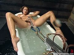Pretty brown-haired girl is having fun indoors. She plays with her snatch in a bathtub and then gets her vag drilled by a fucking machine.