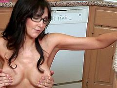 Diana Prince is a nice looking skinny dark haired milf with long legs and amazing big round tits. She shows off her perfect jugs as she rides stiff dick on the floor in the kitchen.