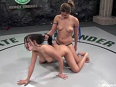 Two hot chicks fight in a ring and then start to fondle each others pussies. After some time Lorena gets her Latin pussy toyed with a strap-on.