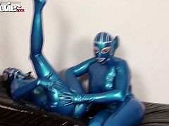 Crazy couple in their tight and blue leather costume having sex