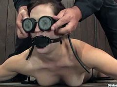 Adorable dark-haired girl Bobbi Starr is having fun with some dude. She lets him put her into irons and beat her with a stick and then enjoys having a toy in her coochie.