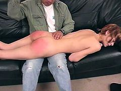 Blonde hottie Zoe takes her blouse and skirt off and leans against a sofa. Some man spanks Zoe's butt brutally and the bitch screams with pleasure.